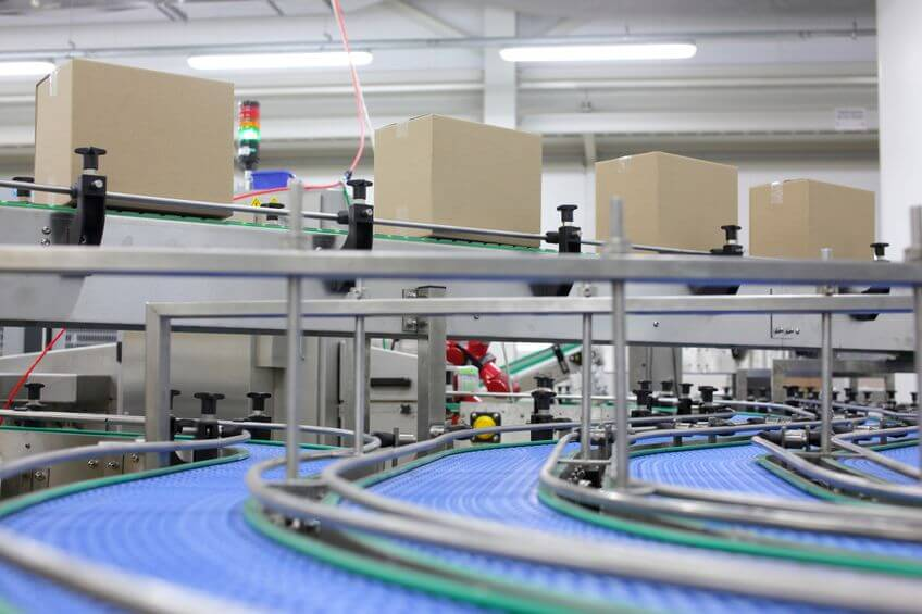 PM for Productprocessing Handling - cardboard boxes on conveyor belt in factory