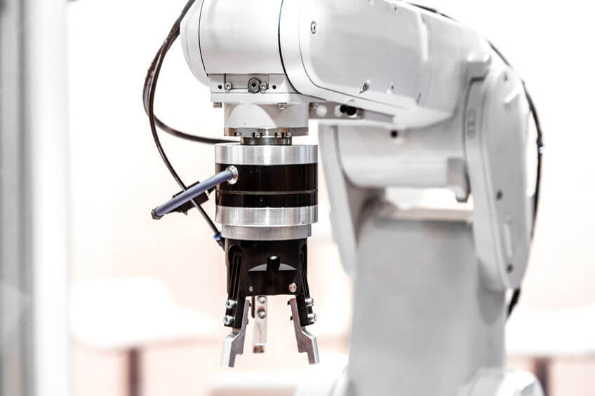 Process automation Industrial robot arm close up