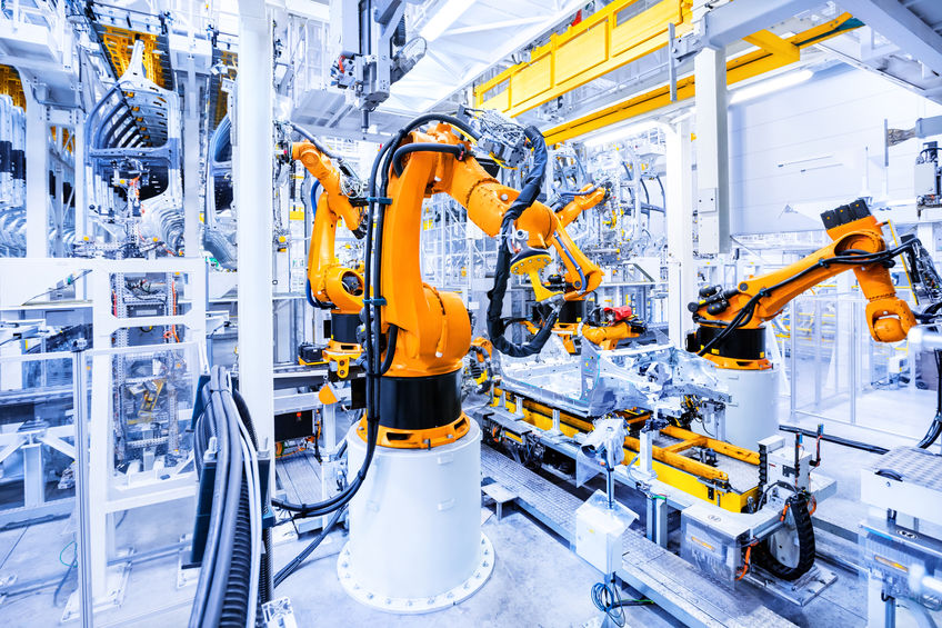 robots in a car plant - PM motors in process automation